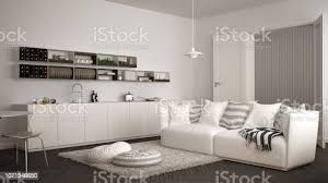 skandinavische moderne wohnzimmer mit küche esstisch sofa und teppich mit kissen minimalistische weiße und graue architektur innenarchitektur