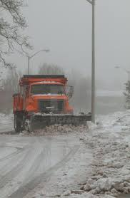 Snowplow Trucks Removing Snow On The Road Street During Blizzard ...