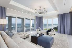 Ocean View Living Room With White Furniture Shag Area Rug Purple Curtains And Chandelier