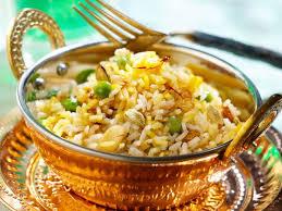cuisine avec du riz riz créole aux raisins et aux pignons recettes femme actuelle