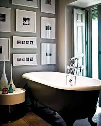 Simple Framed Art With Black Clawfoor Tub For Small Traditional Bathroom Plan