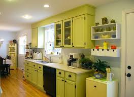 light green kitchen cabinet with modern furniture arrangement warm