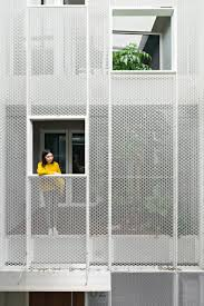 100 Townhouse Facades KC Design Studio Adds Perforated Facade And Atrium To Skinny