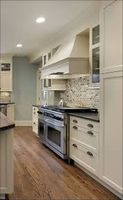 Kitchens With Dark Cabinets And Light Countertops by Kitchen Dark Granite Countertops White Cabinets Black Appliances