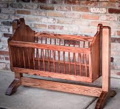 swinging wooden baby cradle handmade from red oak nola