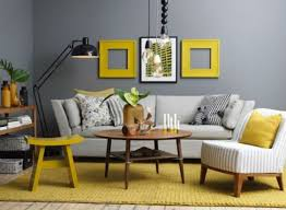 Gunmetal Grey Contrasts With Yellow Frames A Rug And Stool