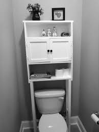 Custom DIY Wooden Cabinet With Tissue Storage And Bookshelf Painted White Color Over Toilet For Tiny Bathroom Spaces Ideas