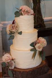 Rustic Three Tier Buttercream Wedding Cake Dressed With Fresh Roses By Emma Page Cakes London