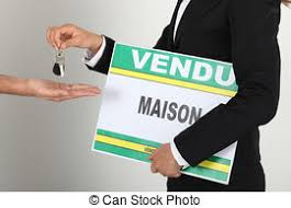 Estate Agent Holding Sold Sign And Handing Keys To Client