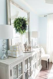 Elegant Dining Room Buffet With Christmas Decor And Leaning Mirror Diningroomdecor