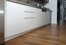 wood floor tile kitchen what color granite with white cabinets and