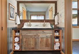 Rustic Double Sink Bathroom Vanity Under Large Framed Mirror And Two Towel Bars On Wooden Wall