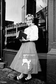 Young Woman Wearing Poodle Skirt And Holding Books