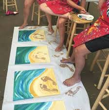 It Looks Like An Art Studio Painted White Canvases And Made A Beach Theme Painting Beautiful Water Sand The Kids Their Feet With Brown Paint