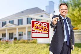 Download Agent With Keys In Front Of Sold Sign And House Stock Image