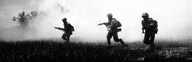 Troops Running Across Marshy Terrain In Vietnams Delta Country During Operations Against The Communist Viet