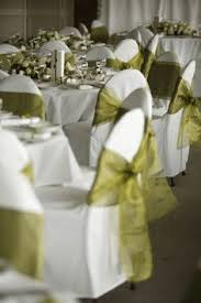 Chair Covers By Sylwia Inc by White Stretch Chair Covers With Red Sashes Surrounded A Table