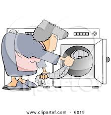 Housewife Putting Wet Clothes Into A Dryer Clipart Picture By