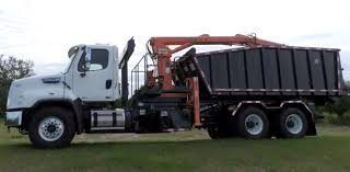 100 Used Roll Off Trucks Model PL3 Off Mount Petersen Industries