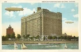 AMERICAN FURNITURE MART – ON LAKE – BOATS – BLIMPS – c1930