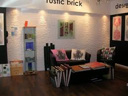 InteriorDream Rustic Brick Wall Painted White Combine Glass Standing Shelves Also Simple Brown Sofa