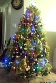 Artificial Tree With Lights Decorations And Large Gold Ribbon Bows Decorated Christmas Trees Small Pre