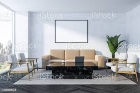 white living room beige sofa and poster stock photo image now