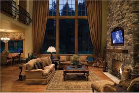 Living Room Impressive Rustic Inspiration With Large Frame Glass Window And Brown Fabric Curtain Also Stone Fireplace Near Tv Wall Unit Added