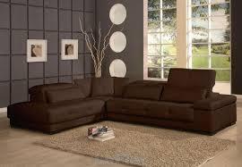 living room brown sectional sofa glass window hard wood floor