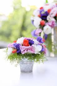 A More Rustic Chic Centerpiece In Re Purposed Tin Bucket The Flowers