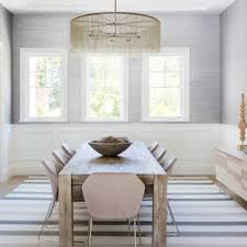 Example Of A Large Coastal Light Wood Floor Enclosed Dining Room Design In Los Angeles With