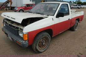 1986 Nissan Pickup Truck   Item H3099   SOLD! Construction R... Twelve Trucks Every Truck Guy Needs To Own In Their Lifetime 19865 Nissan Hardbody Brochure 1986 720 King Of Clean Photo Image Gallery Ext Cab Pick Up This Is The Time Wh Flickr Nissan Pickup For Sale Qatar Living Hard Knocks Safari Fire For Sale Youtube Cabsold Maine Motorland Llc Jn6nd11s5gw050378 Silver Nissan D21 Short On In Ca San D21 Iddle Problem Datsun Wikipedia Auto Bodycollision Repaircar Paint Fremthaywardunion City