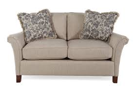 mathis brothers sofa and loveseats textured traditional 63 loveseat in honey brown mathis brothers