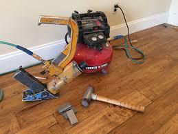 Flooring Nailer Vs Stapler by Hardwood Flooring Installation With Stapler Gun Youtube
