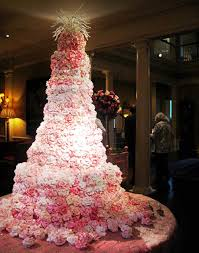Huge extravagant seven tier wedding cake pletely covered with pink roses From Rae Hartsock