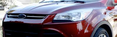 change the headlight bulbs on a ford escape