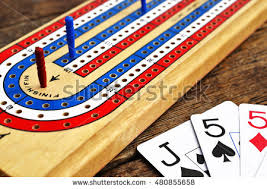 A Low Angle View Of Cribbage Board With Red Peg In The Winning