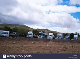 Makeshift Truck Stop With A Few Rows Of Semi Trucks Of Different ...