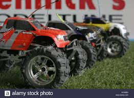 Radio Control Racing Monster Truck Cars On Grid On Indoor Grass ... Emracing Tyrant 18 4wd Brushless Rc Monster Truck 6s Speed Runs Traxxas Maximum Destruction Rtr Incl 84v Battery And Charger Electric Remote Control Redcat Volcano18 V2 118 Scale Mons Trucks New Bright Radio Jeep Orange Big Hummer H2 Wmp3ipod Hookup Engine Sounds Free Shipping Rc Car Climbing Offroad Large Kids Wheel Toy 24 Jam 124 Grave Digger 132 Buggy Off 110 Pro Top2 Lipo 24g 88042 Xmaxx 16 Trucks Monsters Cars