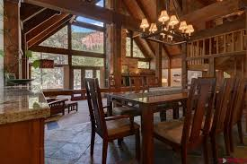 rustic dining room with cathedral ceiling chandelier in durango