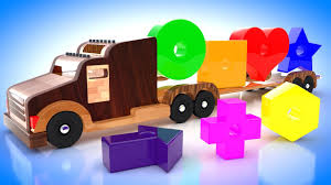 Toddlers Colors With Wooden Shapes Trucks For Kids Carrying Shapes ...