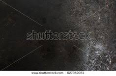Old Metal Floor With Oil Stains Over Light And High Contrast In Background