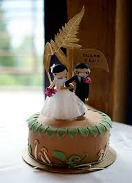 Woodland Themed Cake Topped With Wooden Bride And Groom