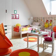 A Colourful Childrens Room With White Bed Made Quilt Cover And Pillowcase