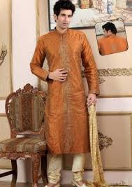Embroidered Raw Silk Kurta Churidar In Orange