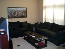 excellent lower living room design with black fabric sofa set and