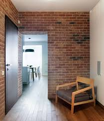 Cozy Studio Apartment Adopting Rustic Style Reflected From Natural Brick Wall And Wood Armchair With Dark Pad Warm Floor Photos Gallery