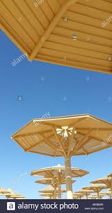 100 Wooden Parasols Low Angle View Of Against Clear Blue Sky
