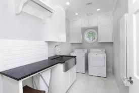 contemporary laundry room with high ceiling built in bookshelf