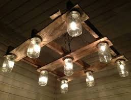 An up cycled pallet and mason jars make for a unique light fixture